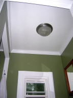 Bathroom ceiling and light fixture. It's amazing what a contemporary fixture does for a room