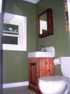Vanity and cabinet made from leftover scraps of pine.